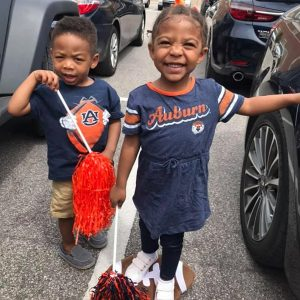 Chase Flowers, an agent and LAH Real Estate's Hoover office, loves Auburn football and so do his children.